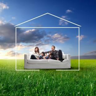 Family on sofa in field